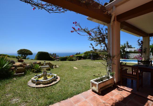 Casa Anselmo - Jardín y porche cubierto